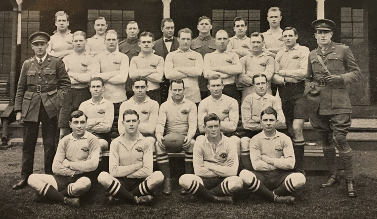 The AIF Reserve Team in early 1919. Back row (left to right): unidentified; unidentified; Driver James 'Jimmy' Clarken (in uniform); unidentified; Gunner James 'Jimmy' Bosward; Lieutenant William 'Roger' Bradley; Sergeant Joseph Murray; Corporal Vivian 'Viv' Dunn; Lieutenant Ernest 'Bill' Cody; Corporal Arthur 'Togo' Lyons; Sergeant Godfrey 'Babe' See. Middle row: Major (Doctor) 'Wally' Matthews (in uniform); unidentified; unidentified; Lieutenant Irving 'Irv' Ormiston, Sergeant Joseph Murray; unidentified; unidentified; unidentified; unidentified; Lieutenant Leslie Seaborn (in uniform). Front row: unidentified; unidentified; Company Sergeant Major Peter Buchanan; unidentified; Corporal Joseph Stevenson. On ground: unidentified; unidentified; unidentified; unidentified. (Soldiers and Sportsmen)