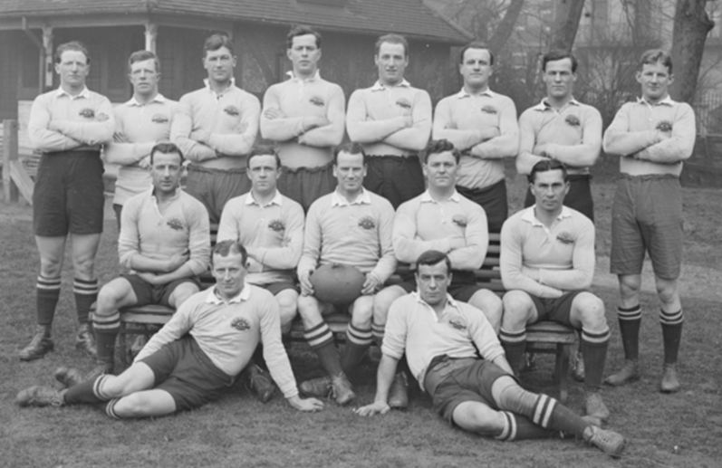 Members of the AIF First XV competing in the King's Cup Competition taken in early March 1919. Back row (left to right): Lance Corporal John 'Bluey' Thompson; Corporal Thomas 'Tom' Stenning; Lieutenant William 'Billy' Watson; Lieutenant Ernest 'Bill' Cody; Sergeant Joseph Murray; Lieutenant William 'Roger' Bradley; Corporal Arthur 'Togo' Lyons; Captain Bruce 'Jackie' Beith. Middle row: Quartermaster Sergeant John 'Plumb' Bond; Corporal John 'Darb' Hickey; Company Sergeant Major Peter Buchanan; Gunner Jack Watkins; Sergeant Godfrey 'Babe' See. Front row: Corporal Dudley 'Dud' Suttor; Private Thomas 'Rat' Flanagan. (AWM D00373)