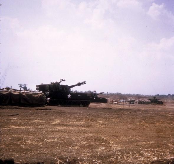 US ARMY 155mm TRACKED HOWITZERS AT ANDERSEN B Battery, 2nd Battalion, 35th Field Artillery, US Army BELOW: US ARMY HUEY 'BUSHRANGERS' AT ANDERSEN Photos: Bob Dabinett OAM 3RAR