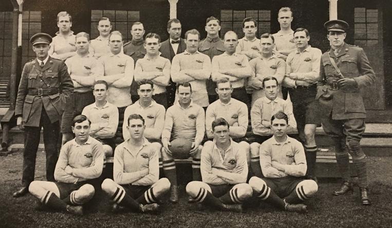 The AIF Reserve Team in early 1919. Back row (left to right): unidentified; unidentified; Driver James 'Jimmy' Clarken (in uniform); unidentified; Gunner James 'Jimmy' Bosward; Lieutenant William 'Roger' Bradley; Sergeant Joseph Murray; Corporal Vivian 'Viv' Dunn; Lieutenant Ernest 'Bill' Cody; Corporal Arthur 'Togo' Lyons; Sergeant Godfrey 'Babe' See. Middle row: Major (Doctor) 'Wally' Matthews (in uniform); unidentified; unidentified; Lieutenant Irving 'Irv' Ormiston, Sergeant Joseph Murray; unidentified; unidentified; unidentified; unidentified; Lieutenant Leslie Seaborn (in uniform). Front row: unidentified; unidentified; Company Sergeant Major Peter Buchanan; unidentified; Corporal Joseph Stevenson. On ground: unidentified; unidentified; unidentified; unidentified. (Soldiers and Sportsmen)
