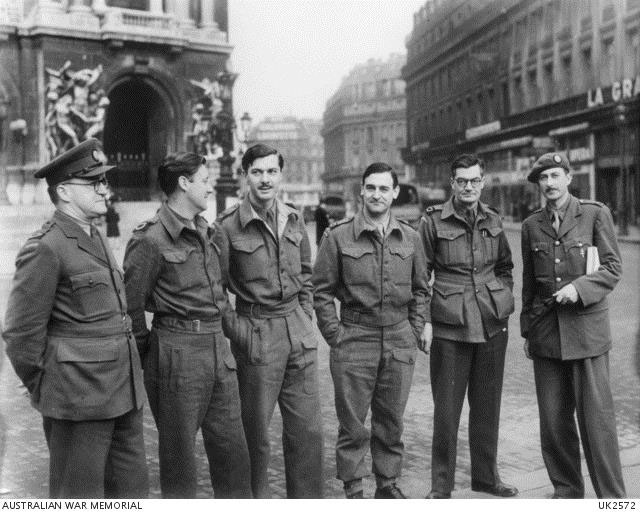 Paris, France. 18 February 1945. Group portrait of Australian war correspondents in the Place de l'Opera in Paris. Left to right: Colin Bingham, of Sydney Morning Herald; Godfrey Blunden, of Sydney Daily and Sunday Telegraph; Geoffrey Hutton, of Melbourne Argus; King Watson, of Sydney Daily and Sunday Telegraph; Henry Bateson of Truth and Sydney Daily Mirror; Colin Wills, of London News Chronicle.